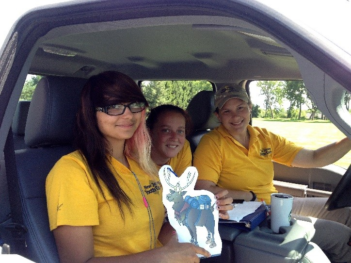 L. to R.  Lydia (holding Eli the Elk) with her fellow Crew Member Tabitha, and Program Coordinator Katie Sullivan at Bread Lock Park in Warren County, NJ.